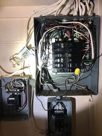 This picture shows a sub panel installation in Santa Barbara right next to a electrical panel in a house.